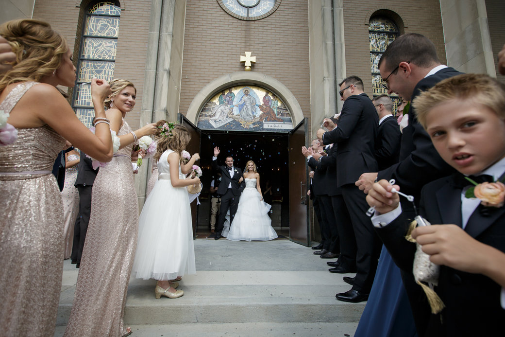 Monique Lhuillier Bridal Gown | Orthodox Ceremony | Church Exit | Chicago Wedding | Cafe Brauer Wedding | Bubbly Moments